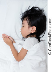 Asian little Chinese girl sleeping on the bed at home