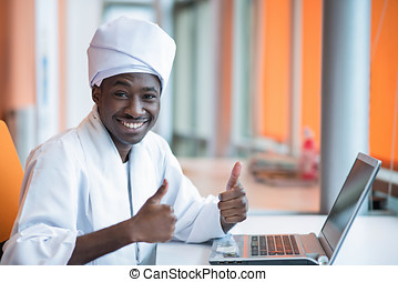 Sudanese business man in traditional outfit using mobile...