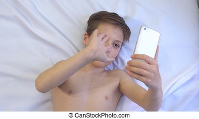 Teen Uses Phone to Chat by Skype. - Teen on White Background...