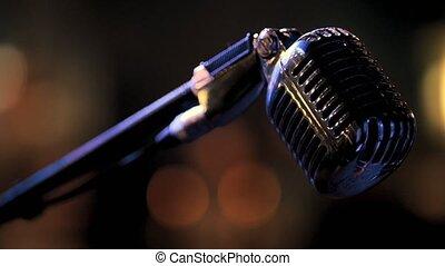 Night club scene - metal vocal microphone, close up