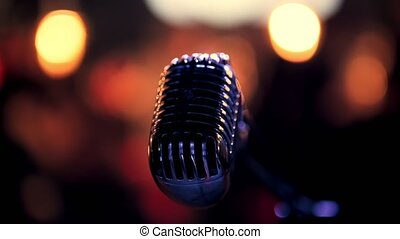 Vocal microphone at concert scene, close up