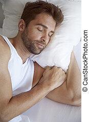 Sleepy head - Man sleeping in bed