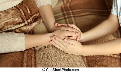 The child tenderly embraced my mother's hands. - Hands of...