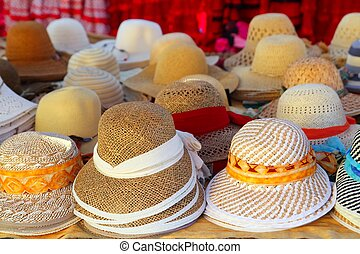 Hats arrangement on market hand craft shop in rows
