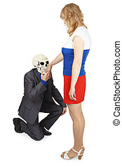 Skeleton kisses hand to young woman - The skeleton kisses a...