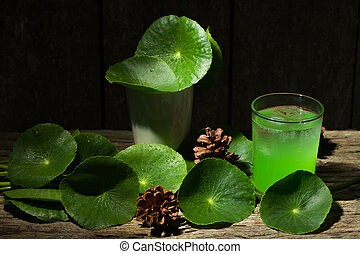Herbal juice from Centella asiatica,wooden scene,Centella asiatica,Gotu kola