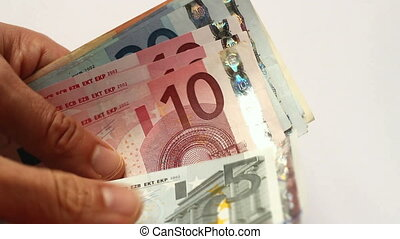 Counting lots of Euro currency cash notes