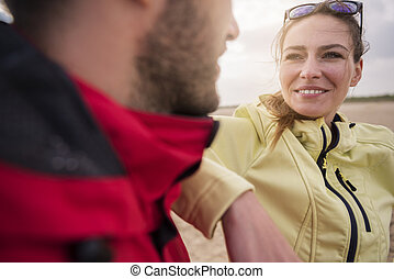 Couple on the beach in windy day