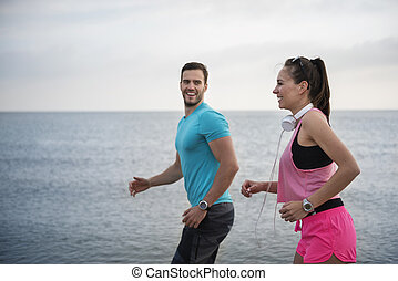 Couple jogging and having fun together
