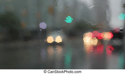 Rainy window with traffic.
