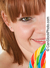 Girl with Lolipop - Red haired woman to lolipop - closeup