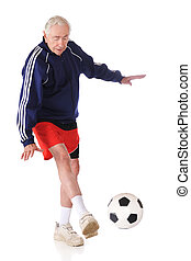 Kicking the Ball - A senior athlete kicking a soccer ball....