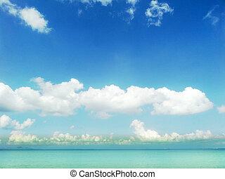 blue sky white cloud and aqua ocean