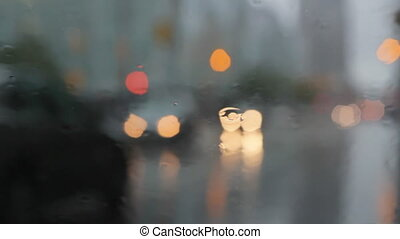 Rainy window with braking traffic - View through rainy...
