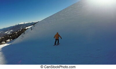 Man Descent on skis from the snow mountains - Dynamic...
