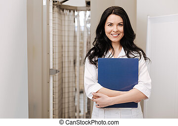 Friendly cosmetologist enjoying responsibilities in the...