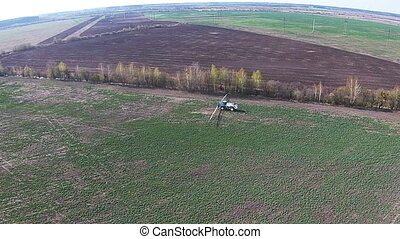 Aerial view of tractor handles the field