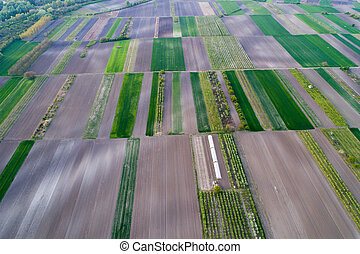 Aerial view of farmlands - Aerial view of plains with...