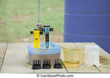Measuring the pH of the water in hydroponic farm. Electronic pH meter