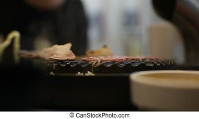 Grilled raw meat cooking on wagyu grill - Grilled raw meat...