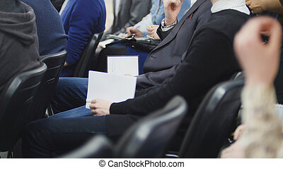 Men and women at a conference or presentation, workshop,...
