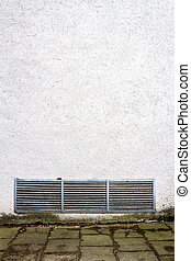 Modern white plaster street wall with ventilation grille....