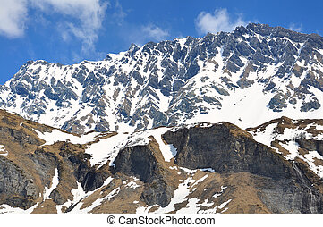 mountain in spring - mountain massif with snow in spring