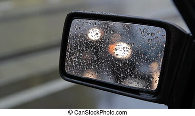 Side mirror. 1 of 2. - View of traffic in side mirror on a...
