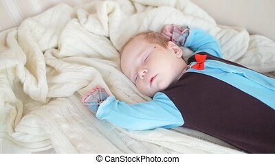 Cute Baby sleeping in bed - Small cute Baby sleeping in bed