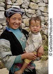 Portrait of a young blue Hmong woma - A Hmong woman with her...