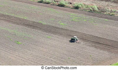 tractor plowing a field aerial view