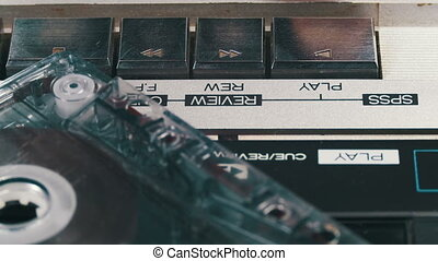 Pushing Play and Stop Button on the Vintage Audio Cassette Player
