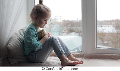 Cute girl with her toy bear