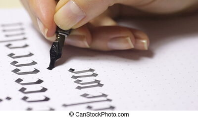 Woman writes pen with calligraphic letters Gothic style,...