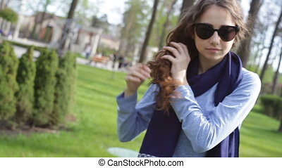 Beautiful young woman in sunglasses braids plait in summer...