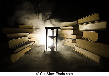 Many old books in a stack. Knoledge concept. Books on a dark background with smoke elements. Bewitched book in center