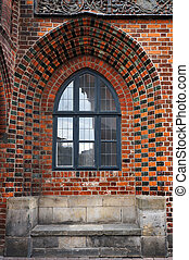 Window in brick wall of Old Town Hall in Hannover, Germany....