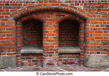 Stone bench in brick wall of Old Town Hall in Hannover,...