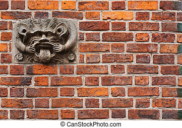 Ancient sculpture of devil on wall of Old Town Hall in...