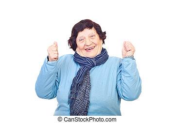 Happy senior woman cheering - Happy senior woman 80s...
