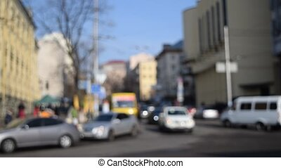 Defocused city with cars and people - Defocused city with...