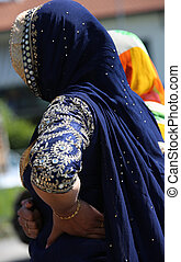 indian woman with decorate blue dress during a festival