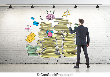 Workload concept - Back view of young businessman drawing...