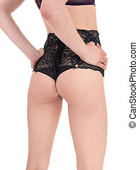 Woman's butt in black lingerie. - The midsection of a young...