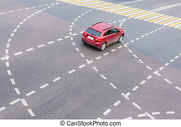 red car at intersection with marking