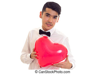 Young man with bow-tie holding balloon - Young confident man...