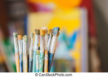 Paint Brushes isolated in colorful backgraund, close-up -...
