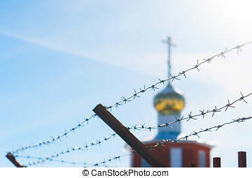 Church behind barbed wire