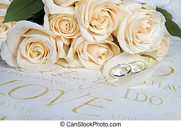 Rose Petal - Wedding rings on rose petal with bouquet.