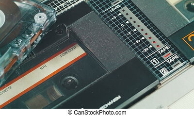 Playing an Audio Cassette in a Tape Recorder - Playing an...